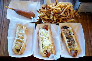 Gourmet_hot_dogs,_corn_dog_and_home_fries